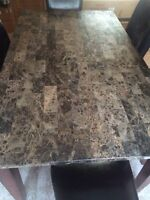 Marble dining room table with 4 bonded leather chairs.