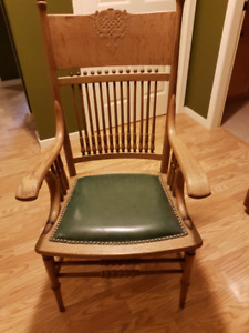 Antique pressed back arm chair.