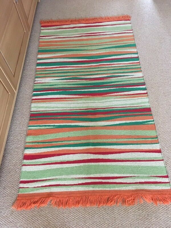 Red Orange Green and Cream Rug
