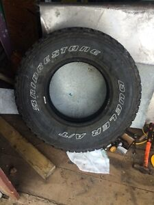 One 265/75/16 tire