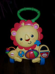 Fisher price trotteur musical lion