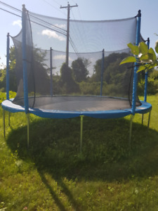14 foot Trampoline with safety enclosure - only 1 year old