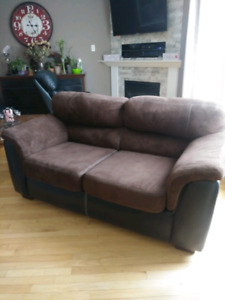 Brown love seat in new condition