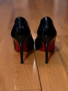 Black round toe patent Louboutin pumps for sale