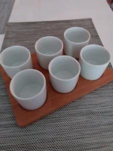 Unused cups on tray.