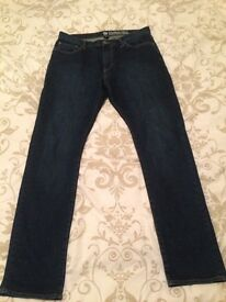 Men's GAP faded blue slim jeans like new, worn once.