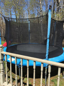 Trampoline ( with net) for sale