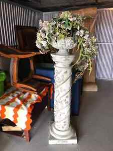 Decorative column with planter.