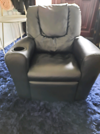 Childrens black leather recliner chair