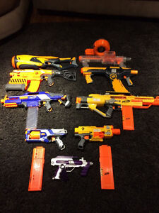 Bunch of nerf guns + bullets for sale
