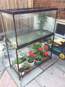 Used 65 gallon tank with tubular stand 36x18