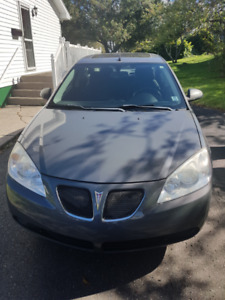 2008 Pontiac G6 SE  Grey 4-door sedan  Excellent condition $5000