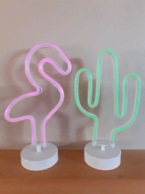 Cactus and Flamingo neon lamps sold as a pair.