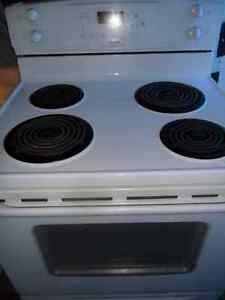 White Self-Cleaning Stove $160. Also have Deluxe Fridge $240.