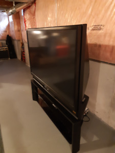 "65"" PROJECTION TV AND STAND"