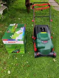 Bosch lawnmower verticut 1100 RRP £229.99 Selling due to moving