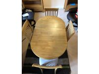 Pine dining table with extendable section and drop leaf