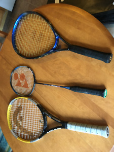 Two tennis rackets and a badminton racket