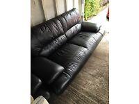 2 black leather 3 seater sofas