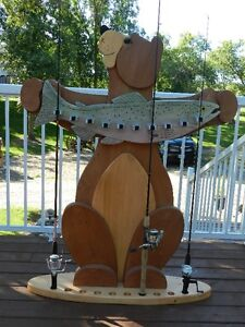 Bear fishing rod holder