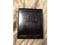 Power beats wireless earphones beats by dre brand new and sealed.