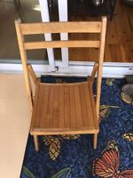 Four wooden folding chairs