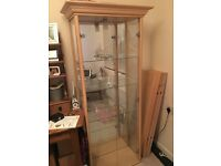 Beech display cabinet with glass shelves and light