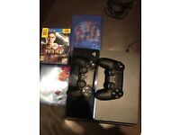 PS4 with two controllers and 3 games