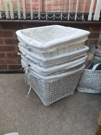 4 white wicker baskets