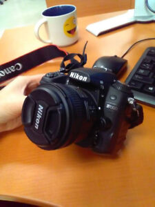 Nikon D7000 with lens 50mm 1.8G and 16-85mm kits