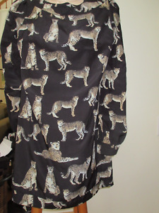 Women's tunic top - Size small  Covered with cheetahs