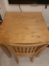 IKEA small wood dining table and a chair