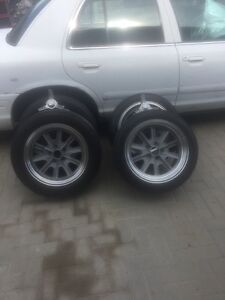 17 inch like new rims and tires with knock offs