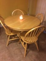 Just reduced. table and 4 chairs and matching hutch.