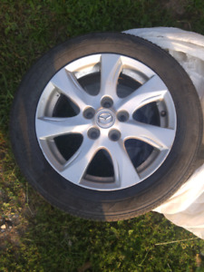 Goodyear tires and aluminum rims. Set of 4.