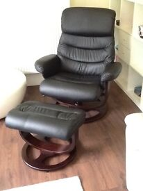 Black faux leather reclining chair and matching footstool