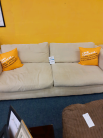 cream couch and arm chair