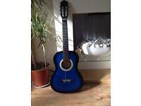Blue 3/4 size guitar.
