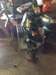 Small decorated christmas tree with lights