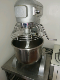 Commercial food mixer with attachments and stainless steel table