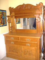 Beautlful antique solid oak buffet and hutch with carvings