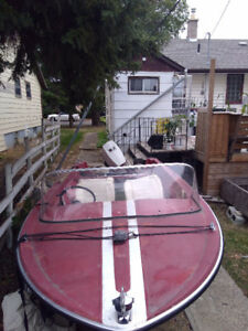 15 Ft boat with a great running 55hp Evinrude
