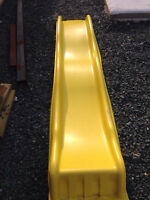 Yellow slide for play fort