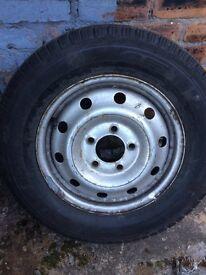 Van wheel and new tyre