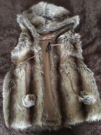 Hooded fur gilet