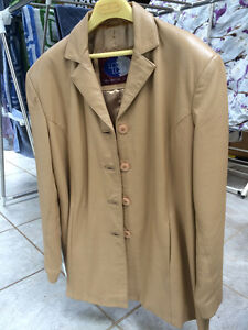Ladies tan leather jacket in mint condition.
