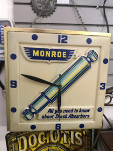VINTAGE MONROE SHOCK ABSORBERS WALL CLOCK