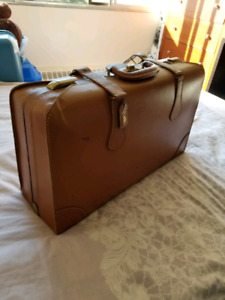 Vintage leather suitcase & Steel toed construction shoes