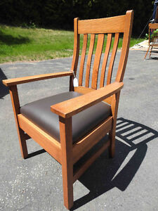 antique arts and craft oak arm chair, new leather seat