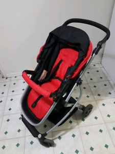 Red and black stroller urbini